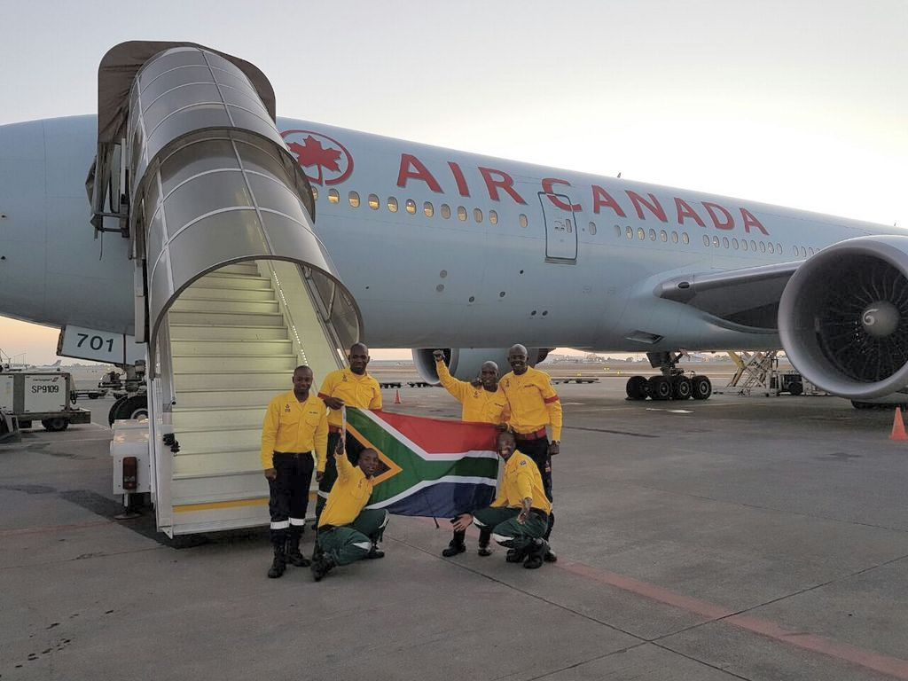 South African firefighters before boarding Air Canada plane to Fort McMurray, Alberta