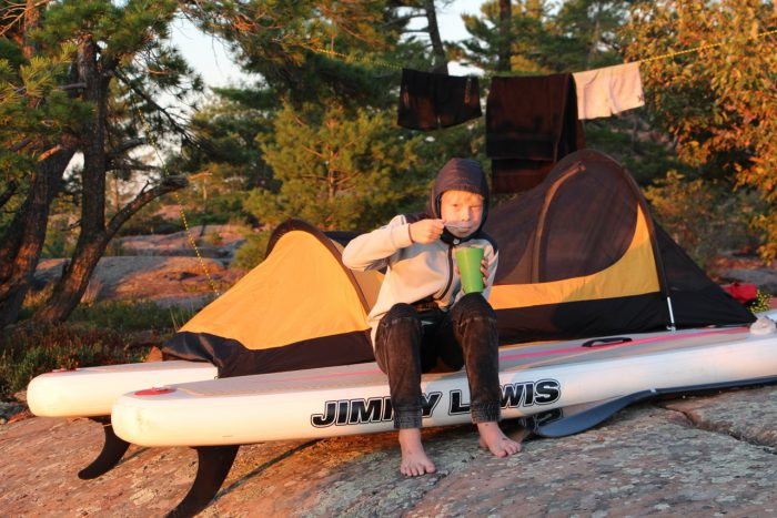 Nathan, his paddle board and tent on his Georgian Bay expedition