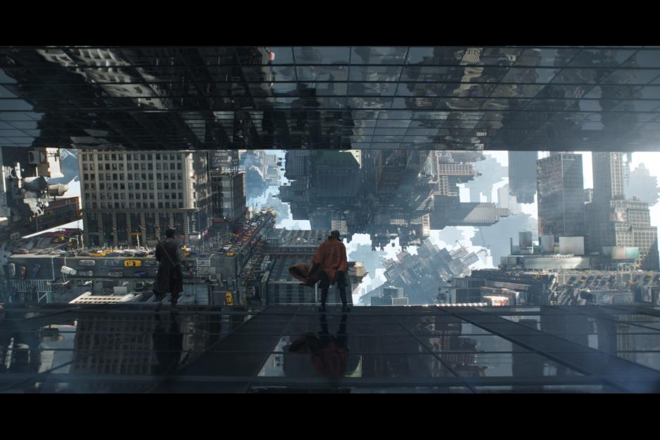 Doctor Strange and Mordo stand on the edge of a skyscraper.