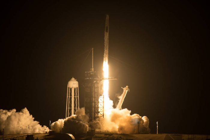 SpaceX launches first crew in recycled rocket and capsule